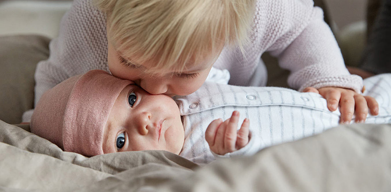 mother kissing baby image