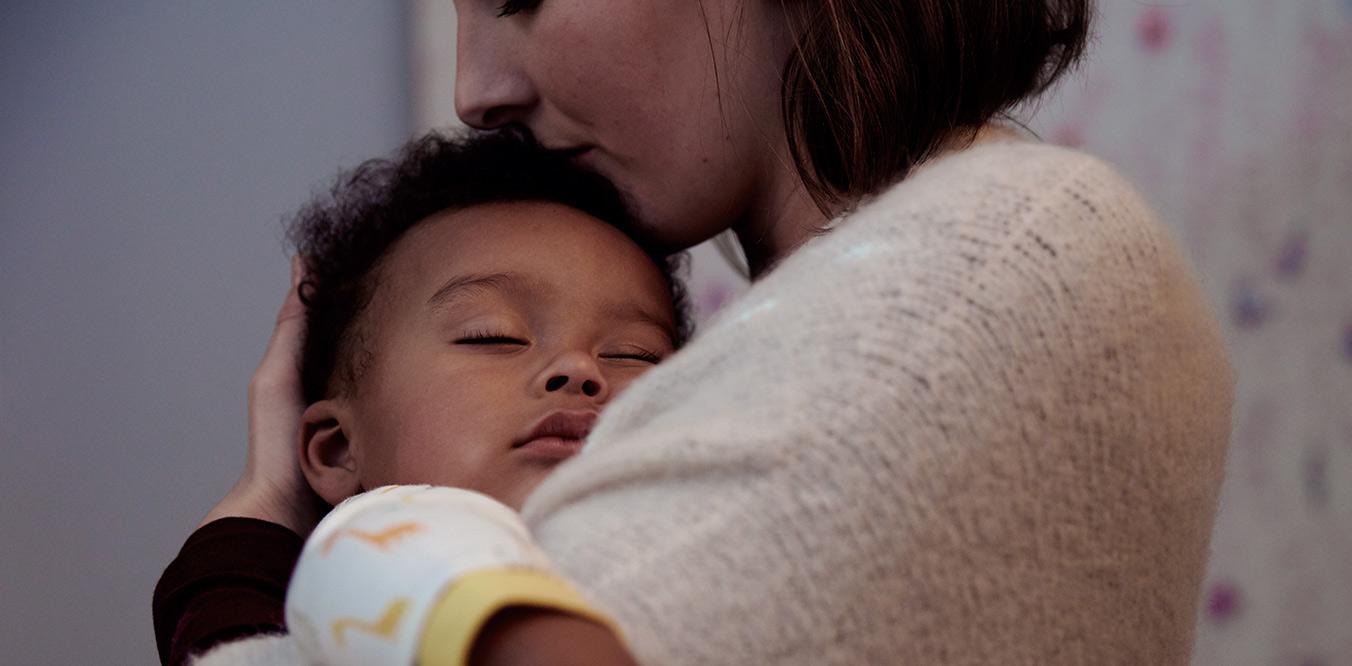 newborn sleeping with mother
